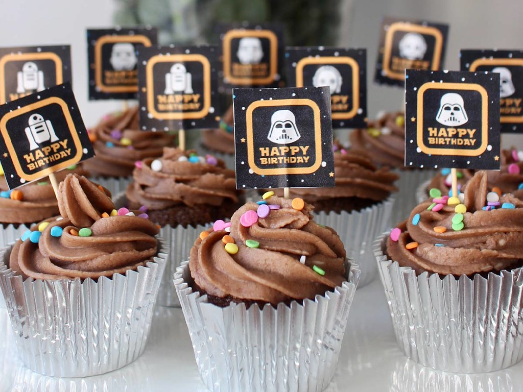 Chocolate cupcakes with mini Star Wars cake toppers.