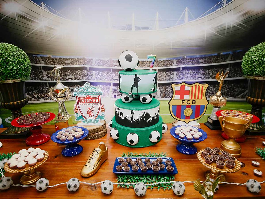 A display of cakes and snacks at a sports themed birthday party.