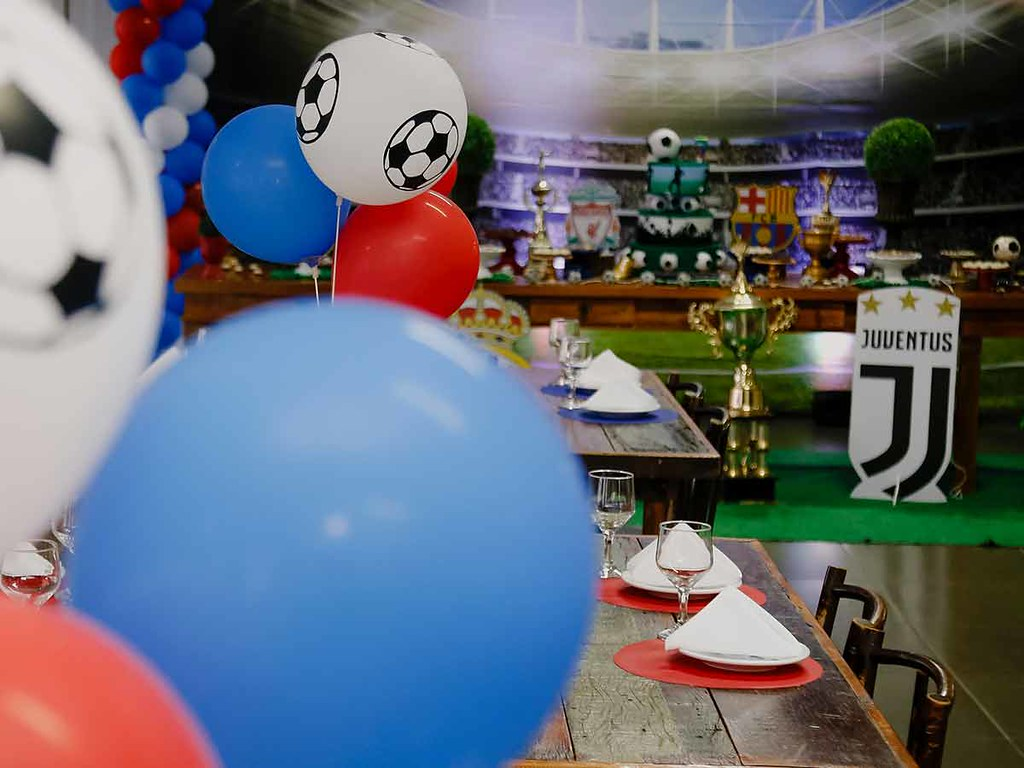 Balloons and decorations at a sports themed birthday party.
