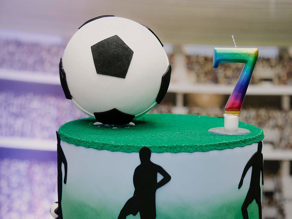 A birthday cake with a large fondant football on top, perfect for sport loving tweens and teens.