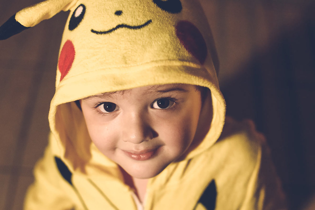 A little boy dressed up as Pikachu.