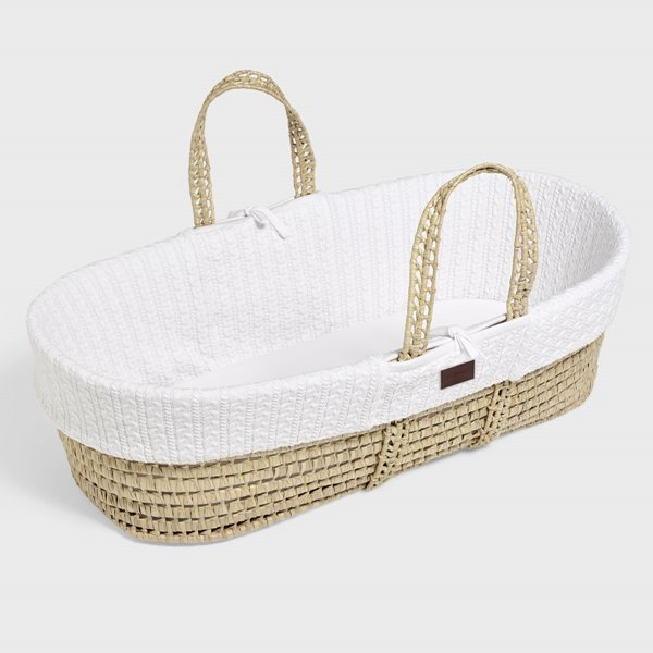 The Little Green Sheep Natural Knitted Moses Basket.