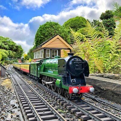 The model train on the tracks at Bekonscot Model Village & Railway.