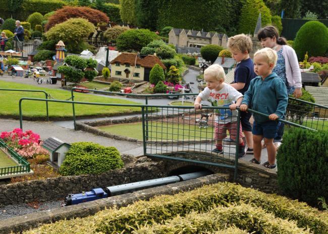 Kids looking over the walkway at Bekonscot Model Village.