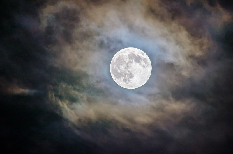 A bright full moon seemingly glowing through the clouds is one of the things you can see in the amazing night sky.
