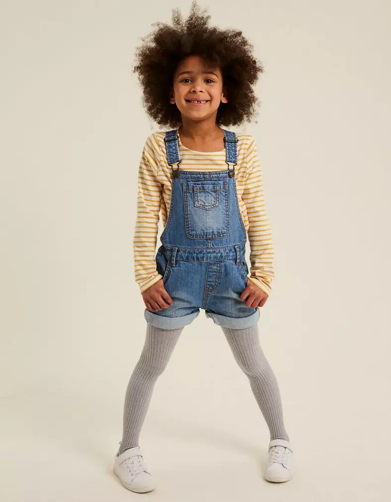 Young girl wearing FatFace Denim Shortie Dungarees.