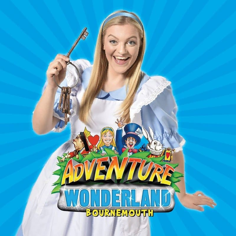 Promo poster for Adventure Wonderland with an Alice in Wonderland character actor holding a key.