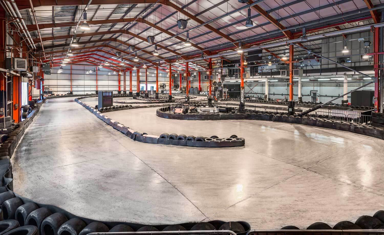 View of the shiny empty track at Formula Fast Indoor Karting.