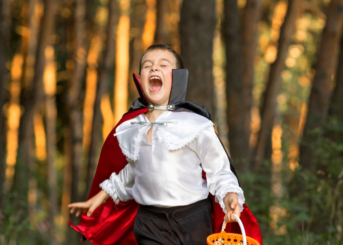 A vampire costume is a great and easy DIY option, like this boy who is running through the forest dressed as a vampire.