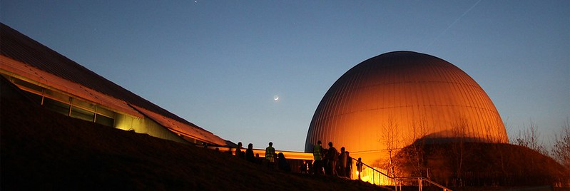 Exterior of the planetarium lit up at sunset at Winchester Science Centre and Planetarium.