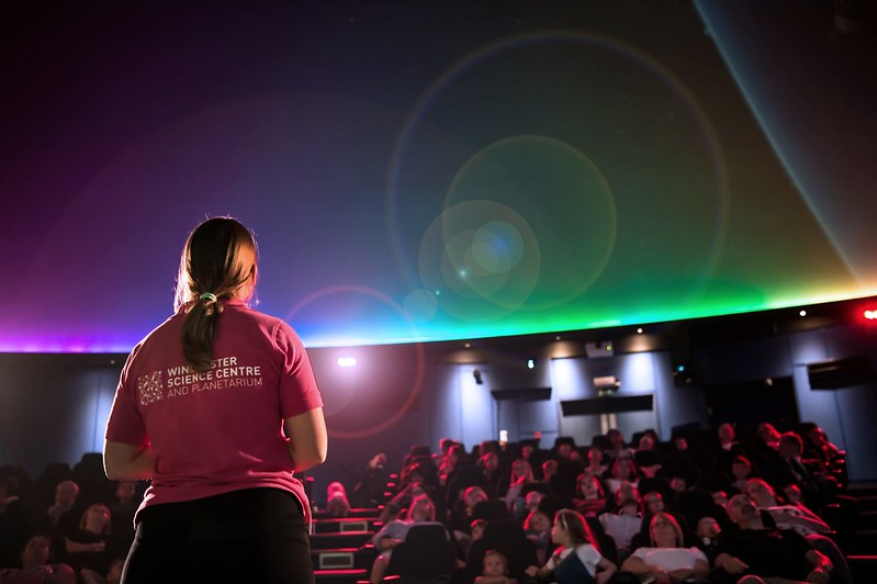 A woman giving a talk at the Winchester Science Centre and Planetarium.