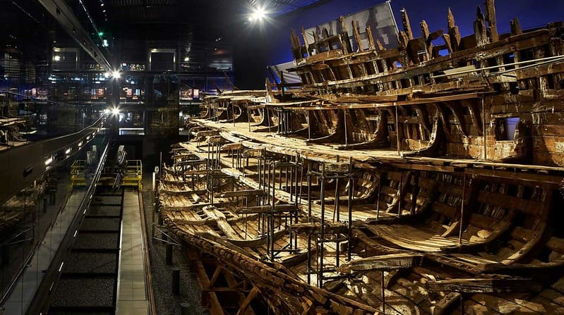 The Mary Rose shipwreck being reconstructed at The Mary Rose museum.