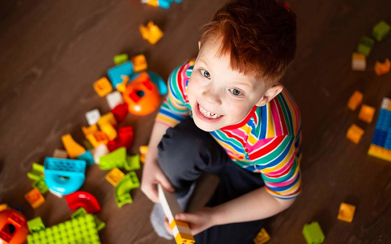 Little boy playing with his lego toys.