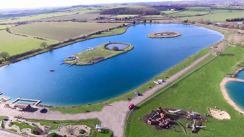 An overhead shot of the expansive lake at Bosworth Water Park.