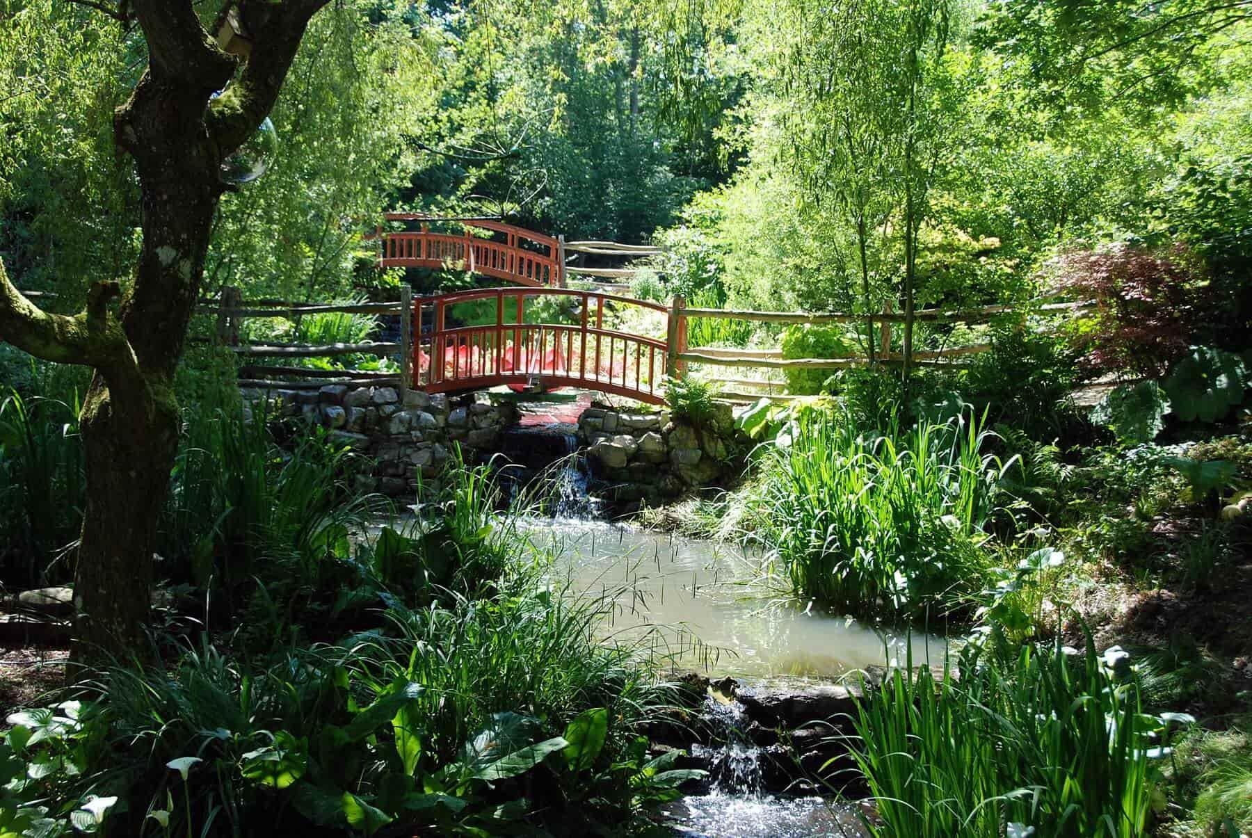 Red bridges criss cross in the historic gardens.