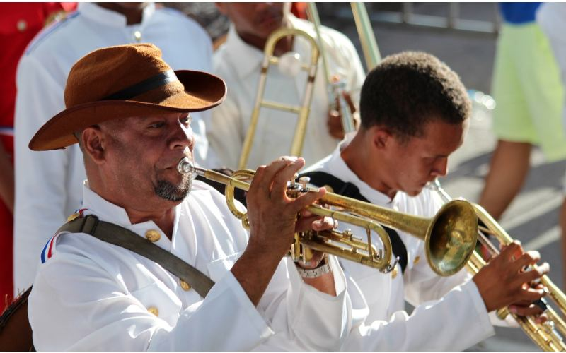 Dominican musican men playing trumpets.