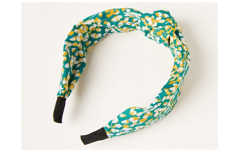 Headband with fresh floral design in blue.