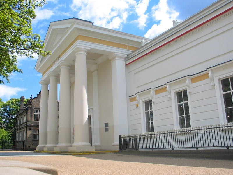 The main entrance of New Walk Museum with grand white pillars.