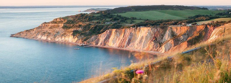 An overview of Alum Bay, showing off the famous coloured sand that makes up the cliifs.