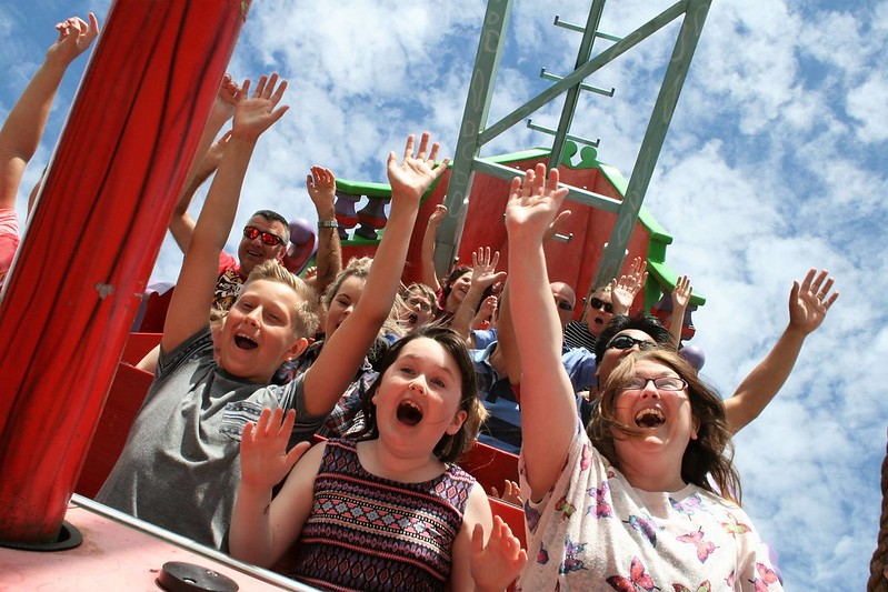 Kids having fun on roller coaster ride at Woodland Family Theme Park.