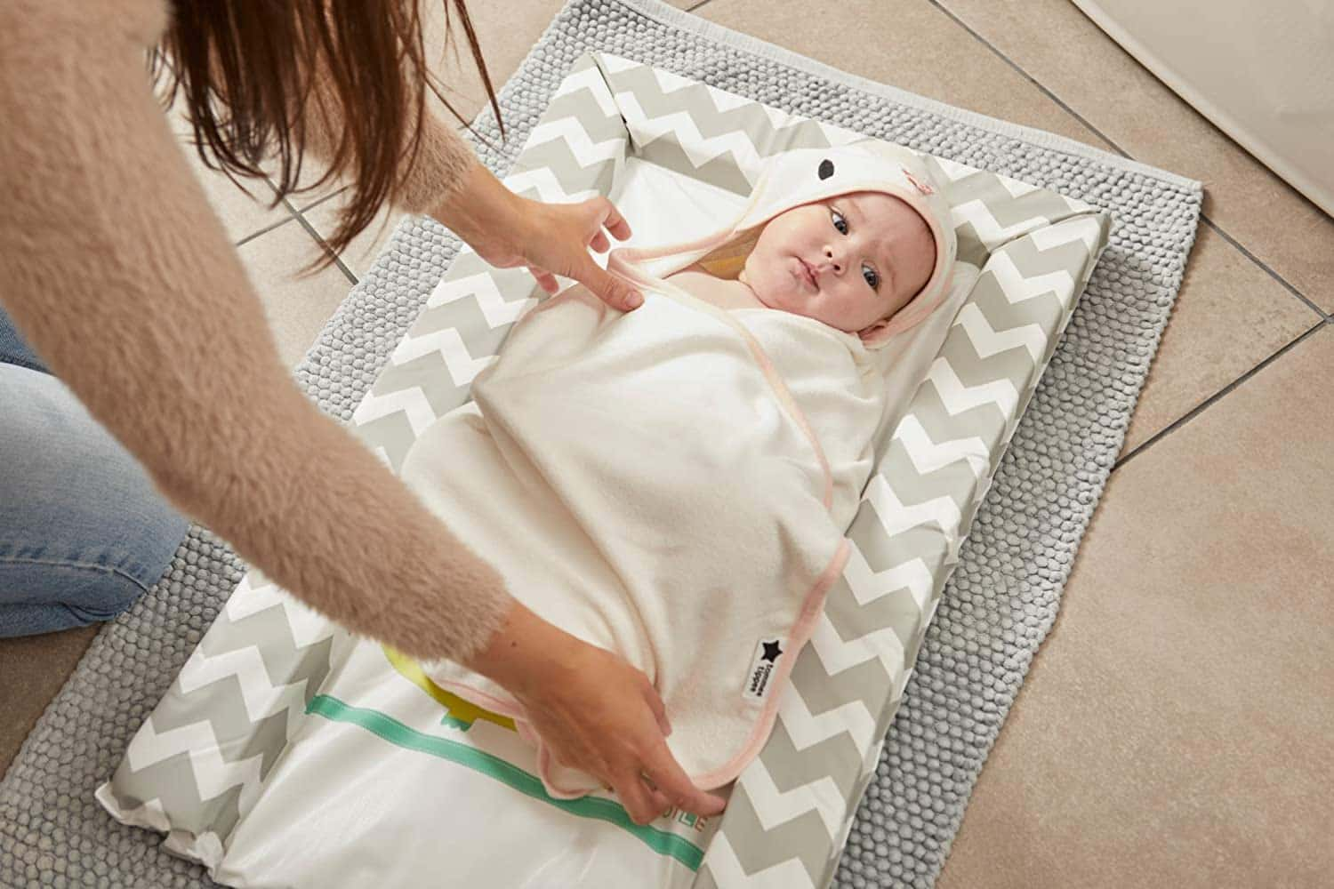 New born baby wrapped in swaddle dry towel.