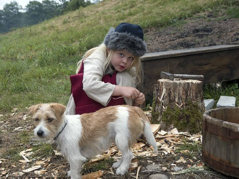 An adorable Scandinavian girl with her pet dog.