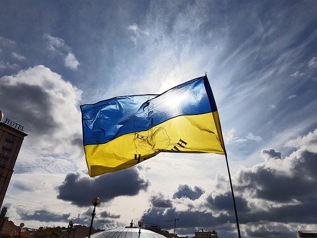 Ukrainian flag amidst a gloomy sky.