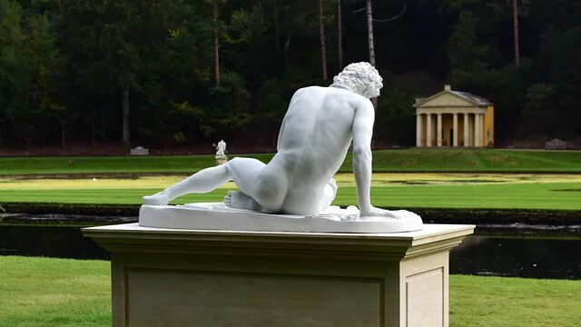 A marble state of a man at Fountains Abbey and Studley Royal.