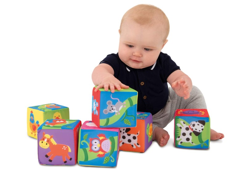 Baby playing with soft, lightweight and perfect for squeezing blocks.