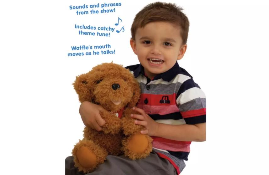 Little boy holding a super cuddly Waffle the Wonder Soft Toy.