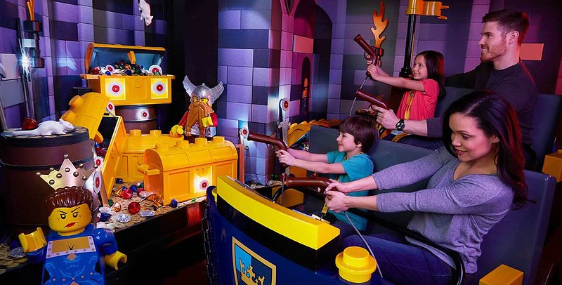 Family enjoying Kingdom Quest at LEGOLAND Discovery Centre Manchester.