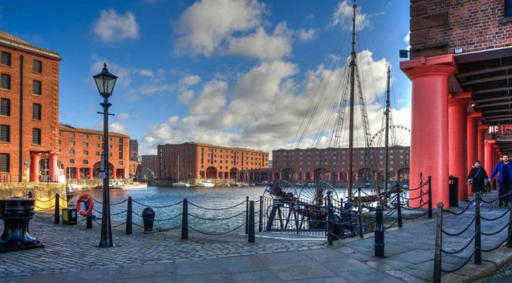 View of the dock and moored boats at Albert Dock Liverpool.