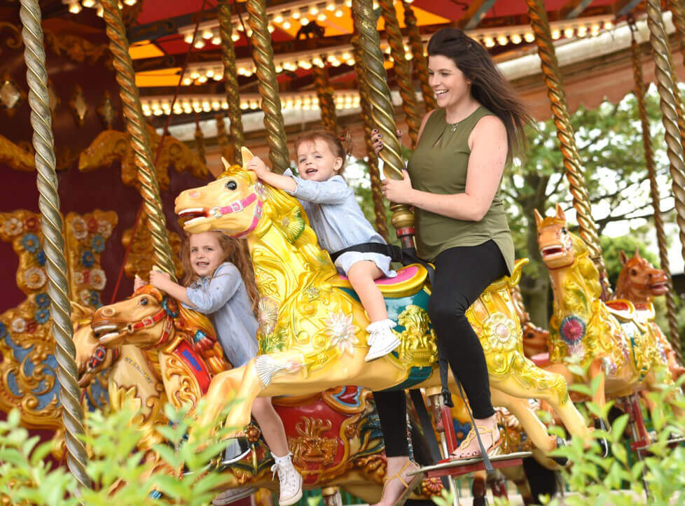 Mother and child on the Carousel at Wicksteed Park.