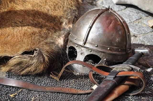Medieval knight's armor, sword and battle headgear.