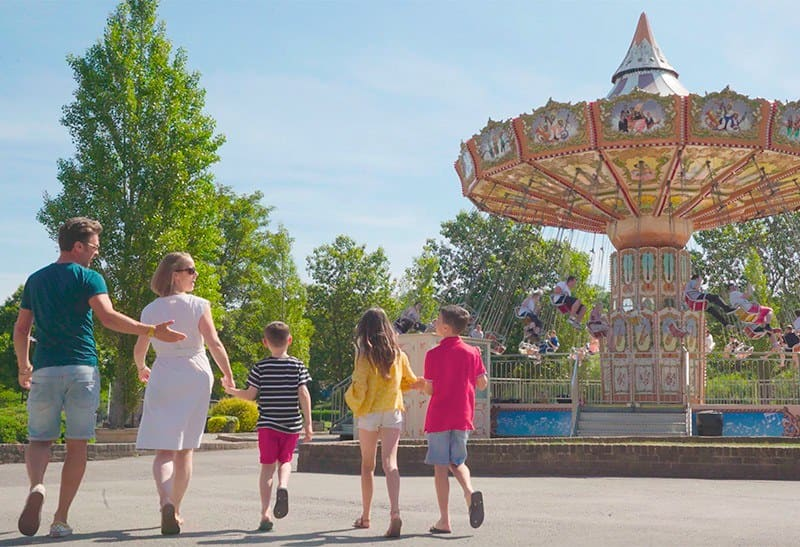 A family walking through Lightwater Valley Theme Park.