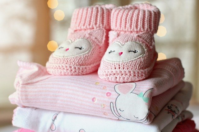 Beautiful crocheted pink clothes and shoes for a baby girl.