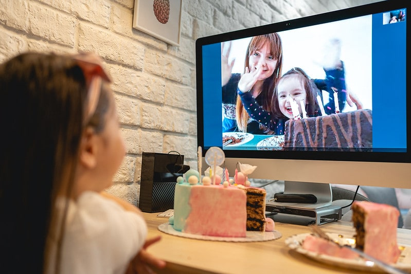 A little girl talks to her family via video call as the new Tier 2 rules in London mean she cannot mix with another household indoors.