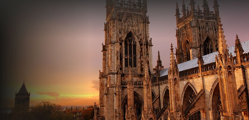 The Gothic York Minster from outside during sunset.