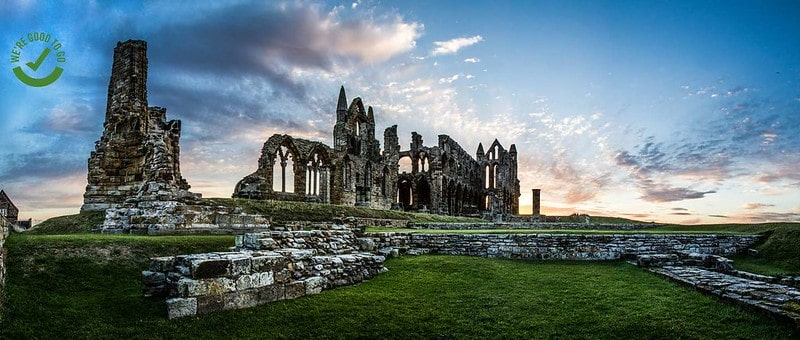 Whitby Abbey in North Yorkshire against a dramatic sky.