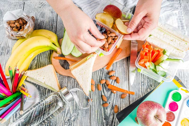 Parent preparin breakfast in lunchbox