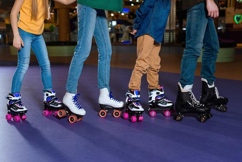 Parents and kids skating on roller rink together