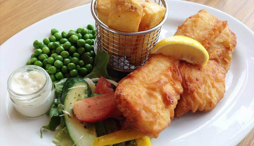Fish, chips and mushy peas served at one of the cafes at the Grand Pier in Weston-super-Mare.