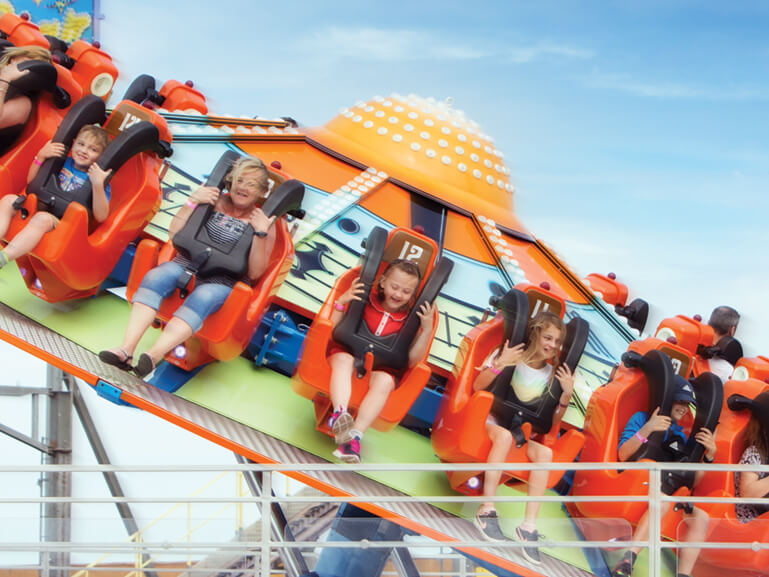 People spinning round on a roller coaster ride at Great Yarmouth Pleasure Beach.