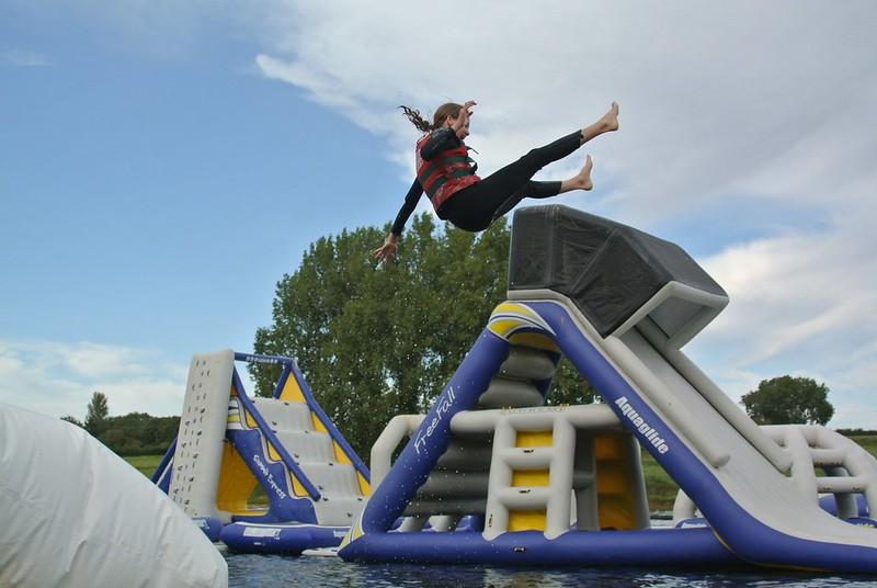 Kid mid air at Aqua Park Rutland.