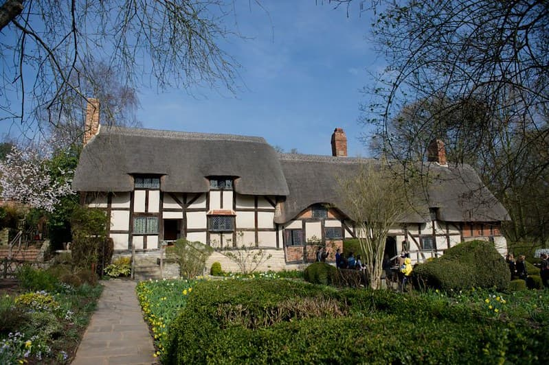 The thatched cottage, Anne Hathaway's Cottage, nestled in a beautiful garden.