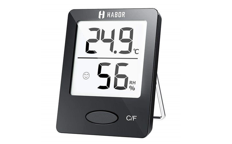 Mini black portable room thermometer and humidity meter.