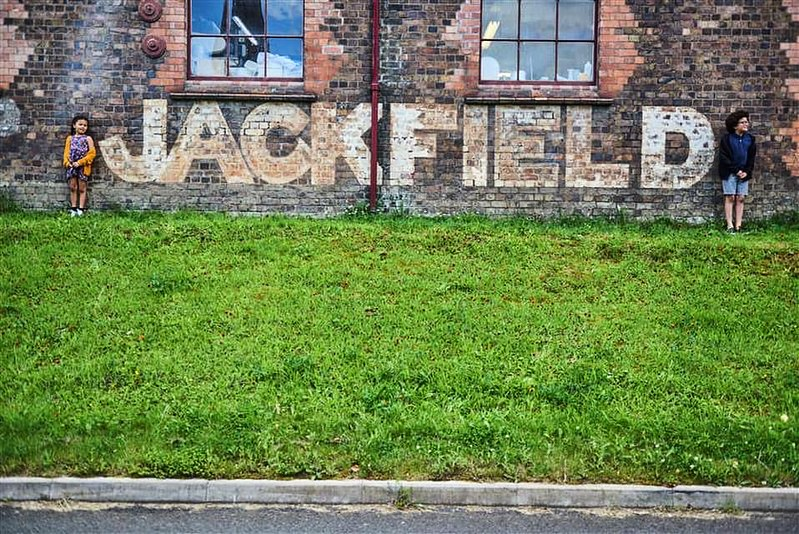 Jackfield Tile Museum sign in front of grass.