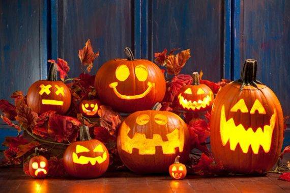 Carving spooky smiley faces into pumpkins is a fun and traditional family Halloween activity.