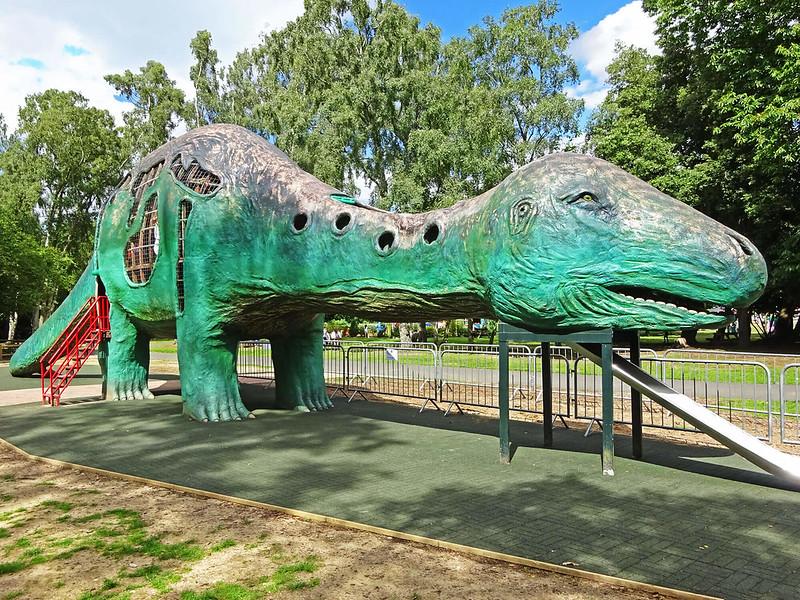 Large green dinosaur-shaped play area at Dinosaur Adventure World.