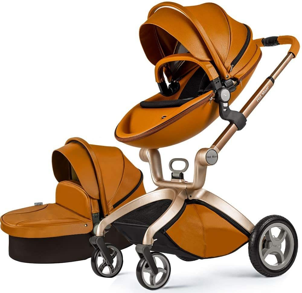 Leather brown black and rose gold metal baby stroller with bassinet.